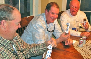 Neal DeForest, right, Joey Young and Dan Turner enjoy an ice cream sandwich.