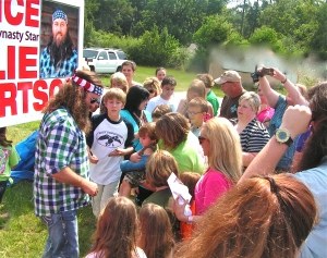 Willie and Ms. Kay sign autographs near Willie's birthplace