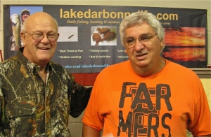 Elzie Culpepper visits with Farmerville Mayor Stein Baughman as they swap stories about the early days of Lake D'Arbonne