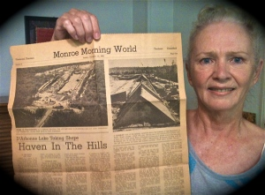 Jennifer Vick with a 1961 newspaper outlining plans for Lake D'Arbonne