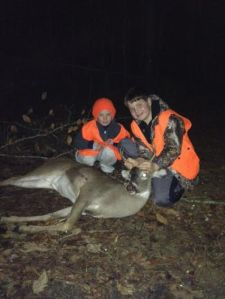 Michael Jones with one of his Holiday deer -- a four point!