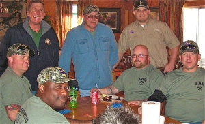 Hunters enjoying lunch at Wild Wings, seated from left, Red Mauck, Phillip Whitty, Daniel Cothren and Steve Keller and standing, from left, Sen. Mike Walsworth, Donnie Vocker and Tray Vocker.