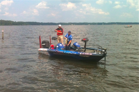 Todd Risinger gets ready to put his 5.72  lunker in the livewell -- one of  Saturday's hourly winners