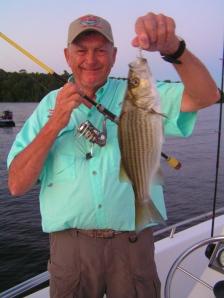 Captain D Donny Hood with a nice Claiborne striper!