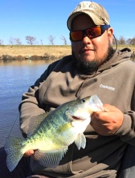 Ronnie Turner shows a nice pre-icepocalypse D'Arbonne crappie. The icechest full shown below is also his...
