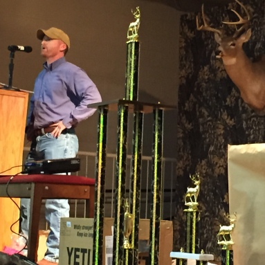 Greg Hicks shares a deer hunting story at the UP Big Buck Banquet