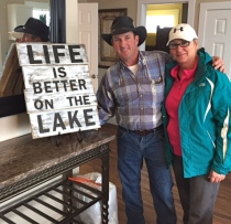 Host Kendal Terral and his wife at one of the new D'Arbonne Point cabins.