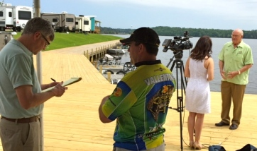 Greg Hilburn of the News-Star interviews Mike Vallentine about Crappie Masters (left) while Ayla Ferrone of KNOE interviews Farmerville Mayor Stein Baughman, Jr., at Lake D'Arbonne Media Day on the gas deck at D'Arbonne Pointe Resort.