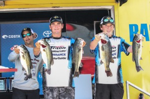 Alex Heintze (middle) and Justin Watts (right), members of the Livingston Parish Bassmasters  win the Costa Bassmaster High School National Championship with a three-day total weight of 66 pounds.