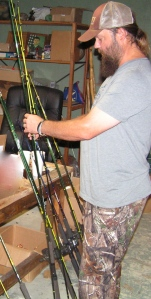 Stone gets the team's B'n'M Duck Commander jig poles ready to roll